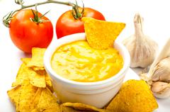 Tortilla chips with tomato and cheese-garlic dip Stock Photos