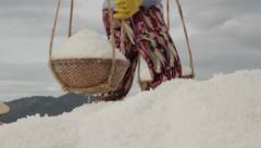 Salt Worker Deposits Salt on Large Hill Stock Footage