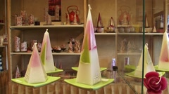Candle shop, interior + pan displayed recycled candles Stock Footage