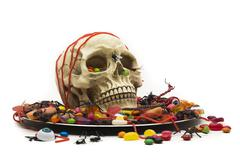 halloween party with trick or treat candy skull dish - stock photo
