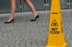 Slippery floor surface warning sign Stock Photos