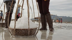 Salt Basket in Foreground Worker in Background Stock Footage