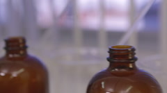 Bottles with liquid in laboratory for testing Stock Footage