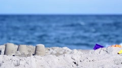 Sand Castle with Blurred Ocean Background - stock footage