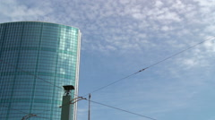 Rotterdam - High rise bell tower blue sky and tramlines - stock footage