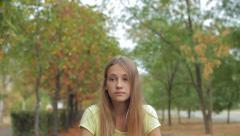 Sad Pensive Teenage Girl In Autumn Park HD Stock Footage