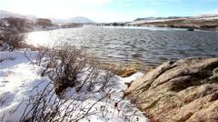 Snowy lake on windy mountain Stock Footage