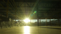 Man walking in direction of camera, low shot against the sun. Stock Footage