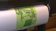 Plotter printing out a landscaping plan - stock footage
