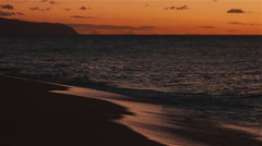 Waves roll in on a Hawaiian beach sunset in 4K Stock Footage