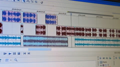 sound mix ,mixing vocal with a vocal in edit room - stock footage