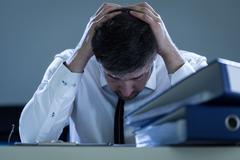 Sad, overworked businessman Stock Photos