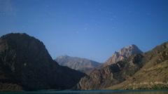 Stars over the mountains. Panorama. Iskanderkul. Tajikistan. Time Lapse. Stock Footage