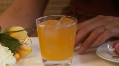Close up woman drinks fruit drink Stock Footage