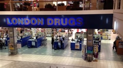 One side of london drugs inside shopping mall Stock Footage