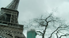 Inside car driving past and under eiffel tower Stock Footage