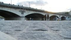 paris bridge over seine camera zooms out bikes pass by - stock footage