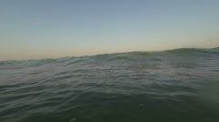 Stock Video Footage of Sea wave flooded the camcorder.