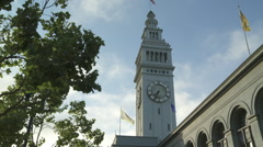 Slow motion ferry building clock tower san francisco wider shot Stock Footage