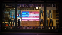 Window Dressing Clothing Display Denim Jeans Broadway American Flag NYC Night - stock footage