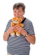 senior woman with teddy - stock photo