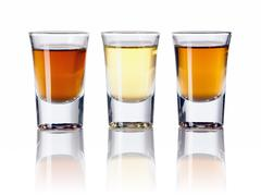 Stock Photo of three kinds of alcoholic drinks in shot glasses