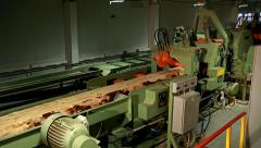 Stock Video Footage of Line for processing wood and timber at the woodworking and furniture plant
