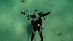 Underwater diver making bubbles, 4k - stock footage