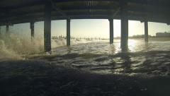 Waves Crashing Under Pier At Sunset Stock Footage