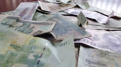 Macro Dolly: WORLD CASH - - Dolly forward along world money Stock Footage