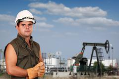oil worker on oilfield - stock photo