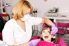 Dentist and little girl patient Stock Photos