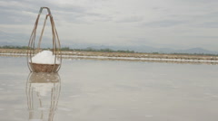 Two Full Bamboo Salt Baskets Collected by Worker Stock Footage