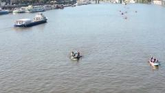 People on board and paddling - canoeing - boats on the river (Vltava) - city Stock Footage