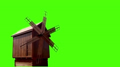 Old windmill isolated on green - stock footage