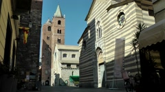 Europe Italy Liguria region city of Albenga 007 towers of cathedral Stock Footage