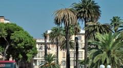 Europe Italy Liguria region city of Albenga 006 tall palm trees and cityscape Stock Footage