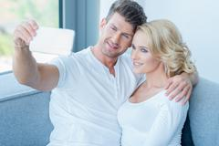 Attractive couple posing for a selfie - stock photo