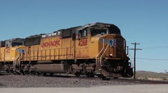 Diesel locomotives powering a long freight train Stock Footage