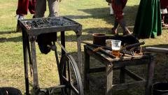 Blacksmith tools - hammer and anvil and other - people around Stock Footage