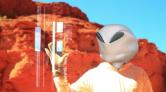 Grey alien using interface computer Stock Footage