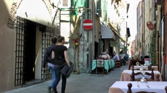 Europe Italy Liguria region city of Albenga 022 restaurants in an old alley Stock Footage