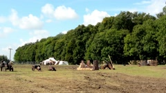 Ancient battlefield - cannons - tents in the background - forest (trees) - sunny Stock Footage