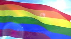 Gay pride flag waving LGBT lesbian gay bisexual transgender Stock Footage