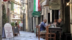 Europe Italy Liguria region city of Albenga 011 pizzeria restaurant in old alley Stock Footage