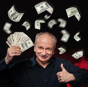 rain of dollar bills. - stock photo