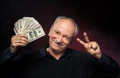 Old man with dollar bills Stock Photos