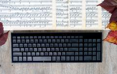 .music scores with a computer keyboard, - stock photo