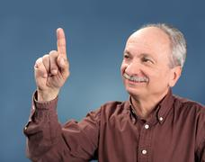 Old man pointing up Stock Photos