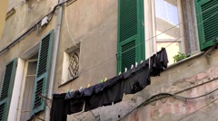 Europe Italy Liguria region city of Albenga 016 clothes line in old alley Stock Footage